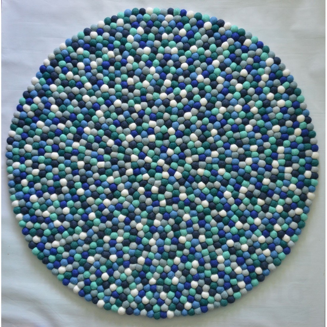 Light golden round felt rug for kids room felt ball rugs for Round rugs for kids